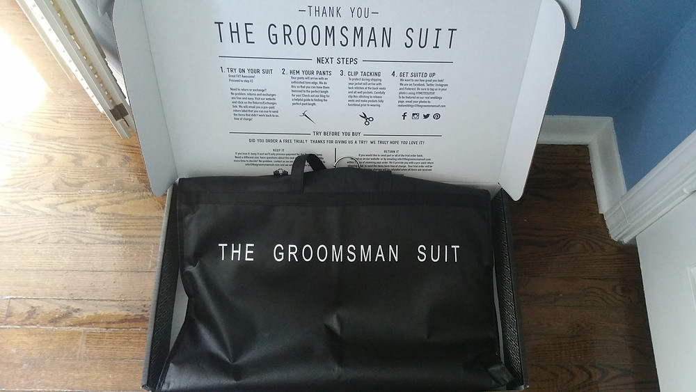 The groomsman suit box and suit bag