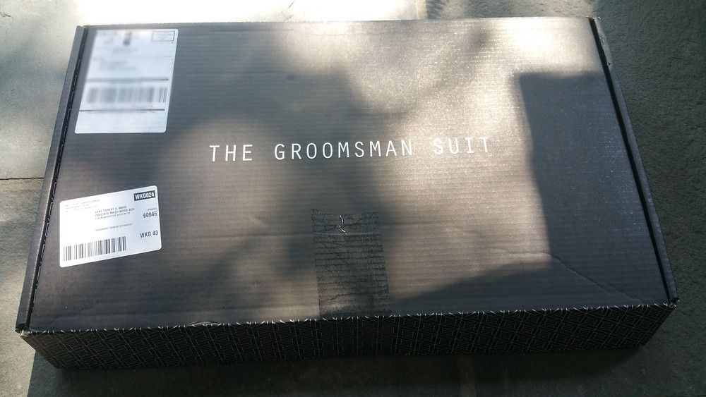 The groomsman suit black box is shipped to your residence