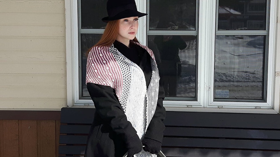 This shawl kit includes five skeins of Peppino, a fingering weight merino, artistically hand dyed by Rhichard Devrieze.