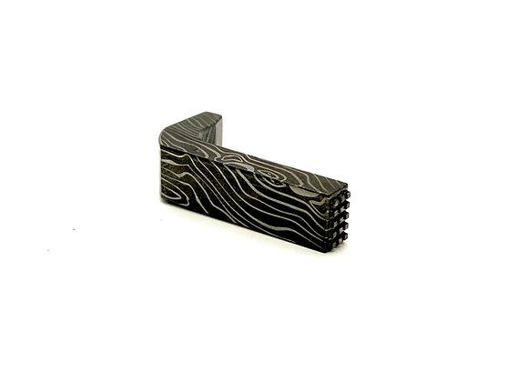 Beskar- Stainless steel mag release.