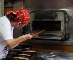Loading the bread oven.JPG