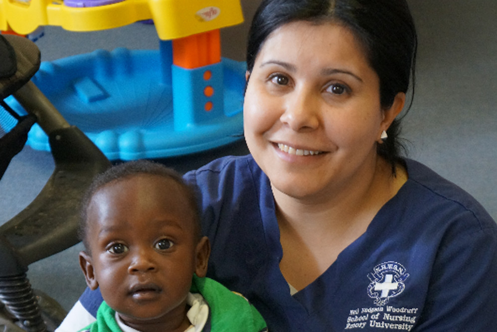 Emory nurse holding young student