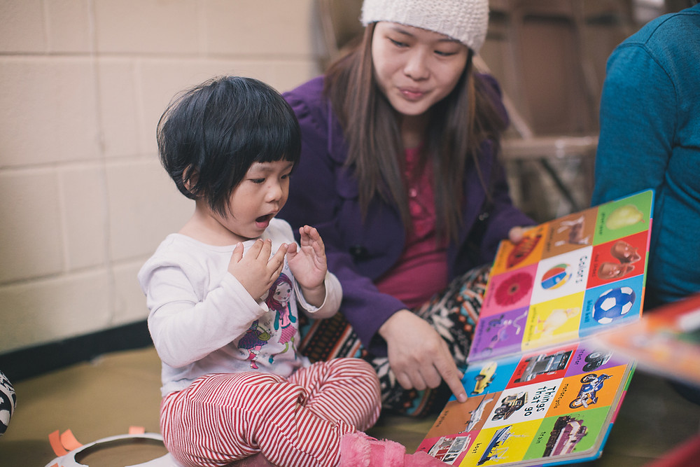 Mother and child participating in Parent and Child Literacy Time (PACT)