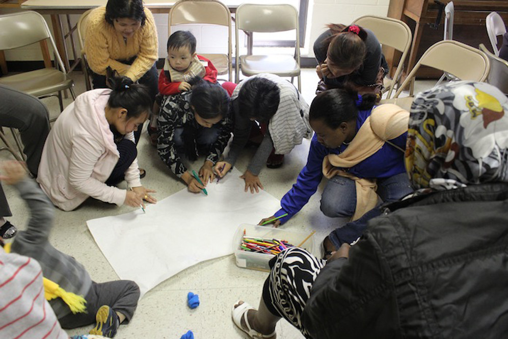 Group of students drawing on paper
