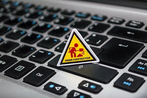 under-construction-signage-on-laptop-key