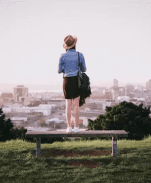 woman standing on a hill