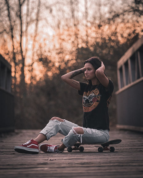 "alt=""Girl sitting on skateboard thinking of her career options"""