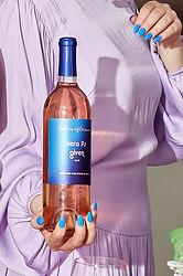 Hand-blue-nails-holding-rose-bottle.jpg