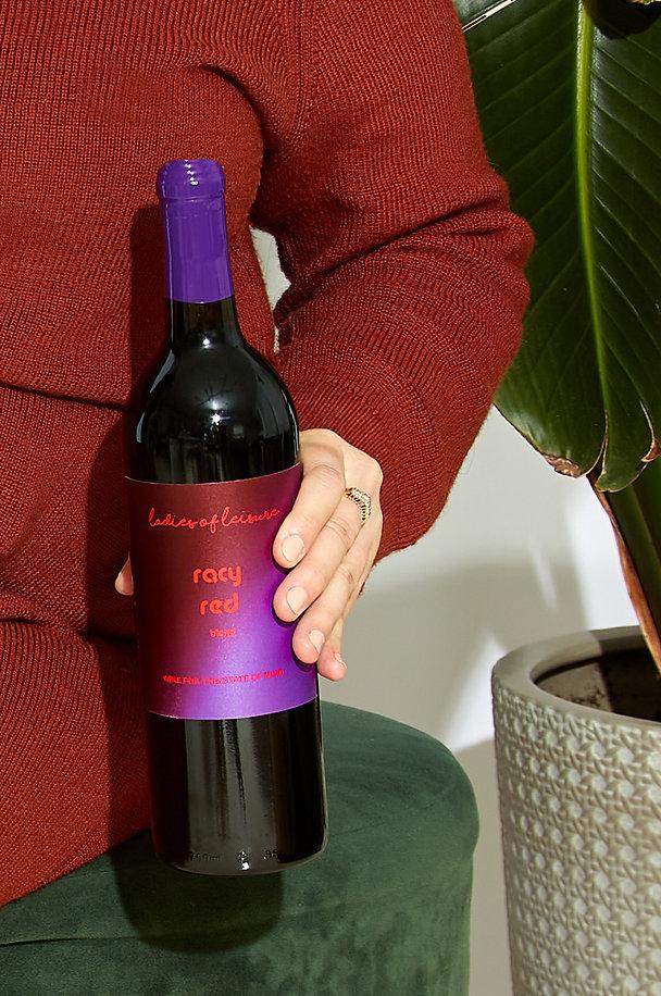Hand-holding-red-wine-bottle.jpg