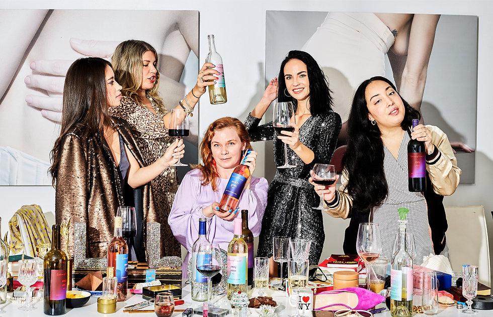Women-dressed-up-celebrating-drinking-wi