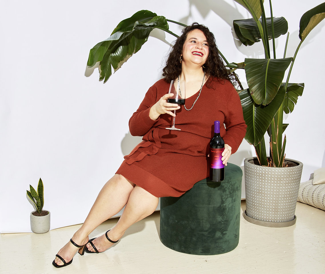 Curly-haired-woman-smiling-drinking-wine