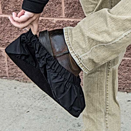 Man Slipping On Shoe Cover