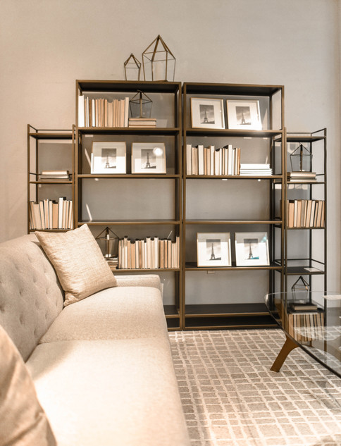 Tidy and Organized Living Room with Bookshelves