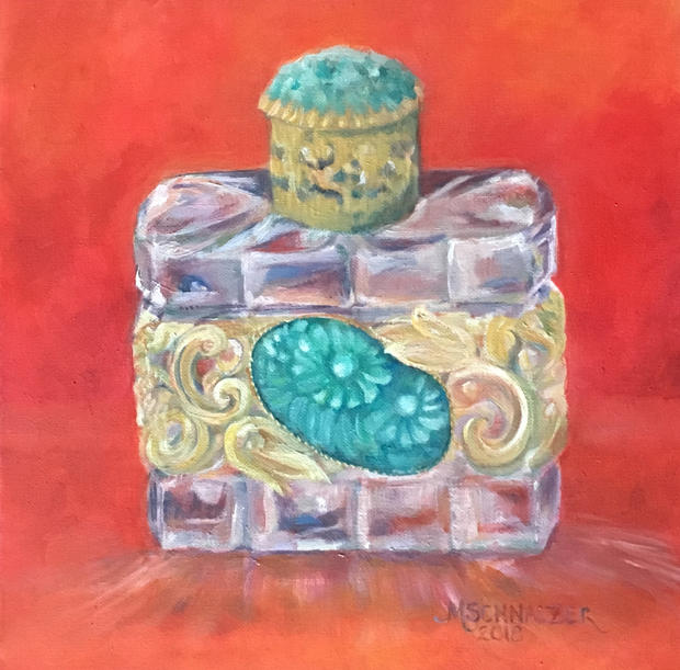 Perfume bottle with green stone