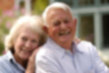 Smiling elderly couple Mindful Home Transitions Senior Moving