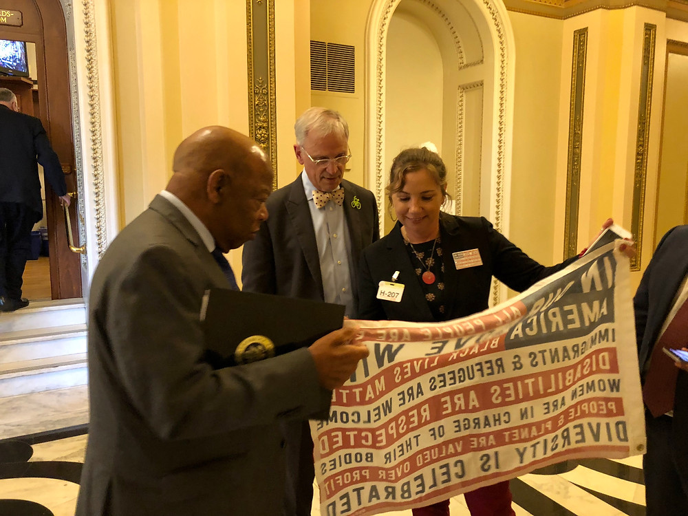 Congressman John Lewis reading the lines of the flag