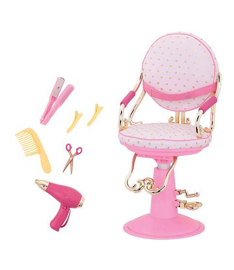 כסא מספרה ורוד עם לבבות זהב וכלי עיצוב שיער