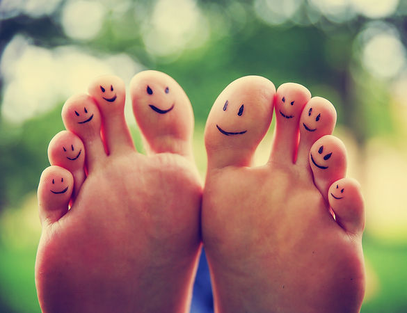 smiley faces on a pair of feet on all te
