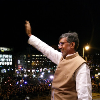 Nobel Peace Laureate Mr. Kailash Satyarthi waving to the throngs of supporters from his hotel balcony in Oslo