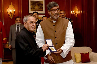 Mr. Kailash Satyarthi presenting the Hon