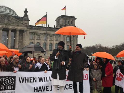 Students march the streets of Berlin with Nobel Peace Laureate