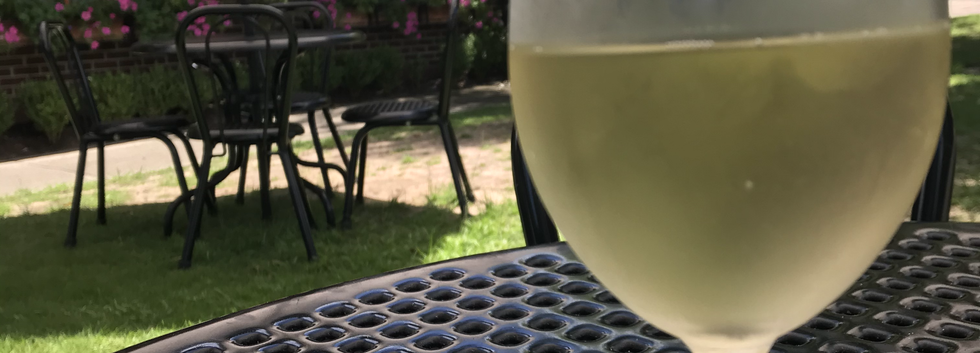 Wine outdoors with background.HEIC