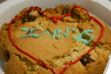 "A cookie decorated with a heart and ""Innis"""