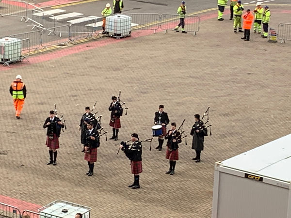 bagpipers on pier in scotland
