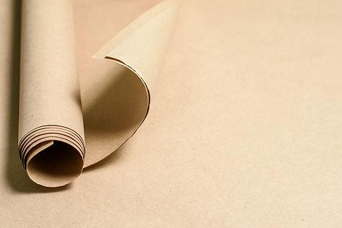 Kraft paper roll on kraft paper backgrou