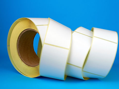 White roll of labels for thermal perfora