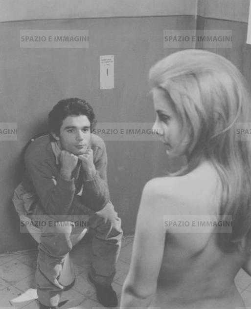 Silvia Dionisio in Italiani! E' severamente proibito servirsi della toilette durante le fermate, 1969. Original vintage print by Antonio Casolini. Gelatin silver print on baryta paper cm. 18x24.