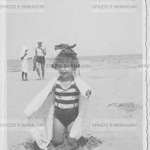Baby girl on the beach. Original vintage print, 1932.  Gelatin silver print on baryta paper cm. 13,5x8,5. Found photo.