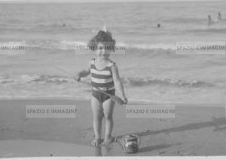 Riccione 1931. Child playing on the beach. Original vintage print. Gelatin silver print on baryta paper cm. 13,5x 8,5. Found photo.
