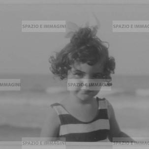 Riccione, August, 193. Portrait of child at the sea. Original vintage print. Gelatin silver print on baryta paper cm. 13x8. Found photo.