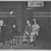Ruggero Ruggeri  with his troupe on set, 40s.