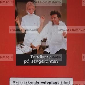 TANDLAEGE PA SENGEKANTEN/ BEDSIDE DENTIST; directed by John Hilbard, ( DK), 1971. Film brochure (pp.2) cm. 21x30 ( closed) cm. 42x30 ( open).
