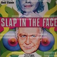 SLAP IN THE FACE/ OHRFEIGEN, directed by Rolf Thiele, (DE), 1970. Film brochure ( pp. 4) cm. 21,5x30 ( closed) cm. 30x52 ( open).