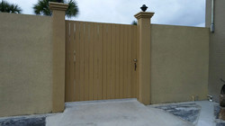 Wood Privacy Gate in Wall