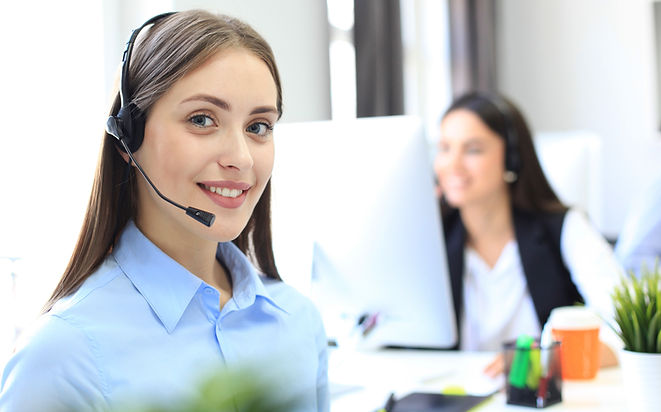 Smiling female call centre operator doin