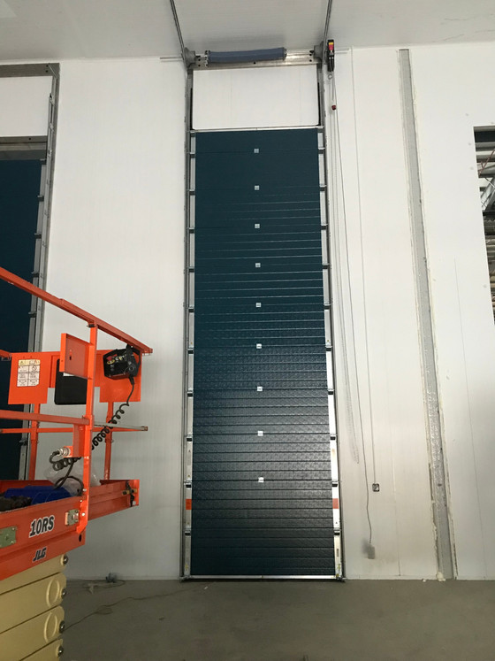 Rapid Action, Insulated Sectional and Roller Shutters installed at a new build site in Haydock