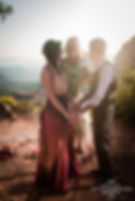 "Enocha ""Ranjita"" of Your Heart's Home Retreat Sanctuary officiating a wedding in Sedona nature setting."