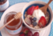 The Greek Kitchen Raw Honey, served with Greek yoghurt, muesli and fresh fruit.