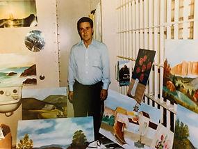 Lucas In Cell w. Paintings.JPG