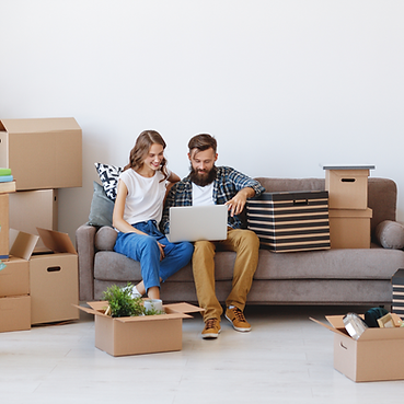 Couple unpacking on lounge RelocateUs.png