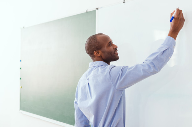 smiling-african-american-teacher-writing