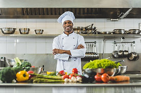 handsome-african-american-chef-standing-