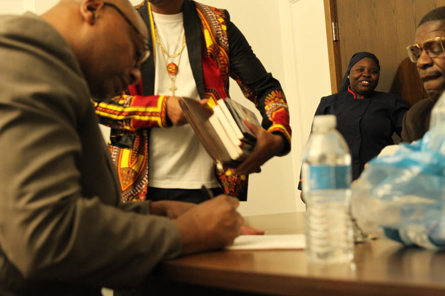 Brothers taking care of business! Look how happy the woman is at seeing her brother sign!