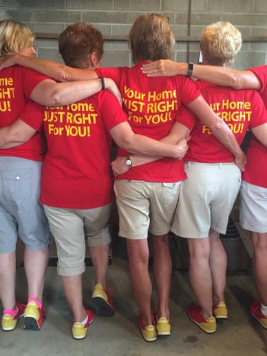 Goldilocks Solutions showing off employee t-shirts