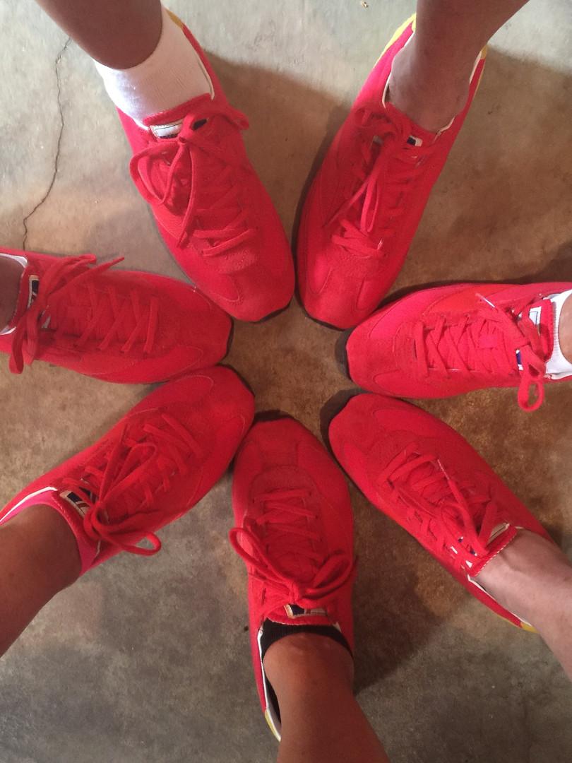 Goldilocks Solutions red sneakers