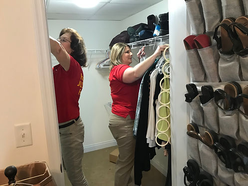 Organizing Team from Goldilocks Solutons working on client closet
